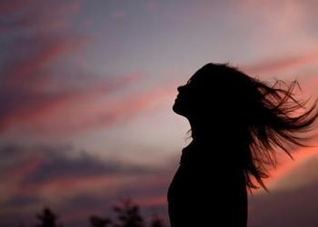 Beautiful woman silhouette beach summer night